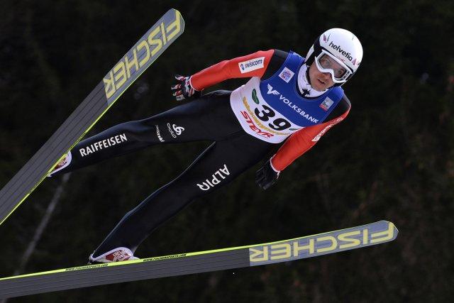 Le Suisse Simon Ammann a remporté quatre médailles... (Photo Samuel Kubani, AFP)