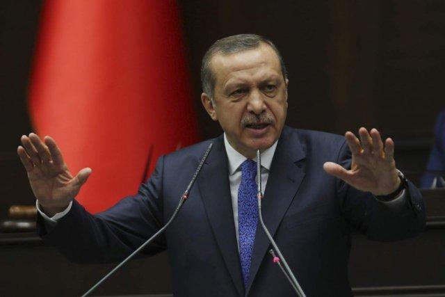 Le premier ministre turc Tayyip Erdogan s'est adressé... (Photo ADEM ALTAN, AFP)