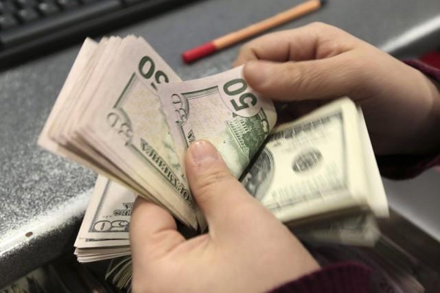 Si l'appréciation du dollar américain par rapport au... (PHOTO EMRAH GUREL, ARCHIVES ASSOCIATED PRESS)