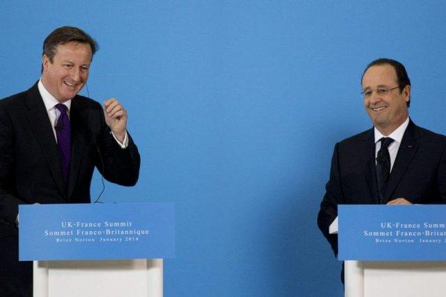 David Cameron et François Hollande... (Photo Matt Dunham, Associated Press)