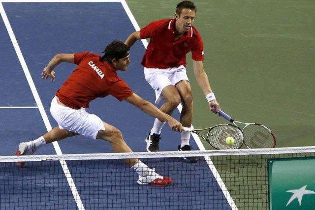 Frank Dancevic et Daniel Nestor ont perdu en... (Photo Yuya Shino, Reuters)