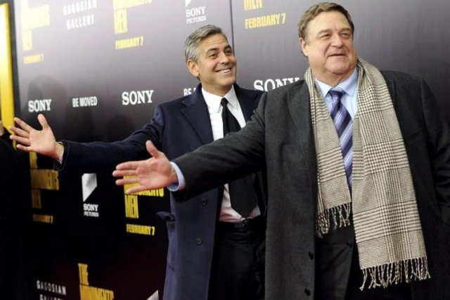 George Clooney et John Goodman.... (Photo Evan Agostini, Associated Press)