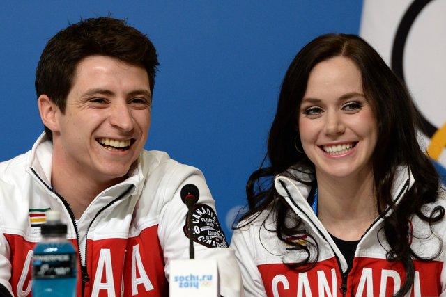 Les patineurs canadiens Scott Moir et Tessa Virtue... (Photo Andrej Isakovic, AFP)