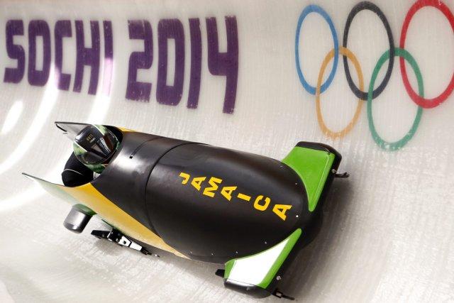 L'équipe jamaïcaine de bobsleigh a effectué ses deux... (Photo Arnd Wiegmann, Reuters)
