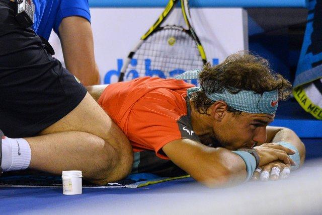 Rafael Nadal faisait s'est blessé au dos en... (PHOTO SAEED KHAN, AFP)