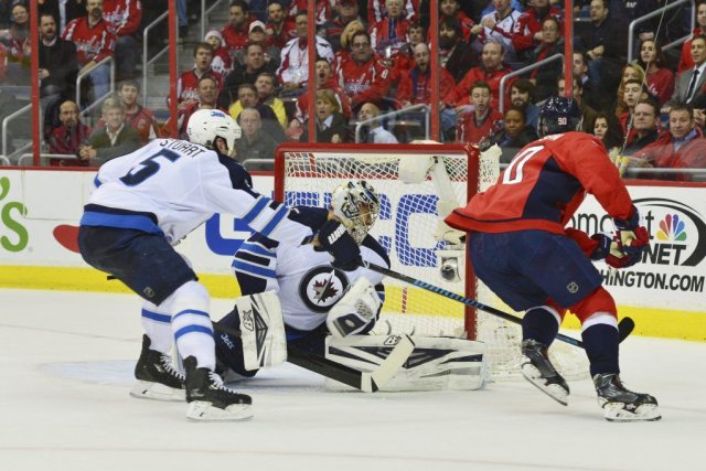 Troy Brouwer (20)a marqué deux buts pendant le... (Photo Tommy Gilligan, USA TODAY Sports)