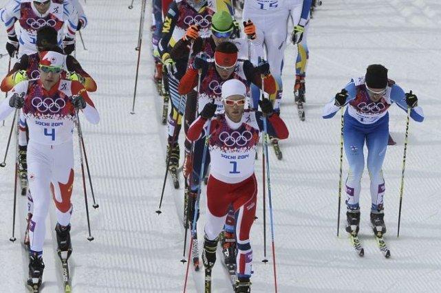 Le Québécois Alex Harvey, à gauche.... (Photo Pierre-Philippe Marcou, AFP)