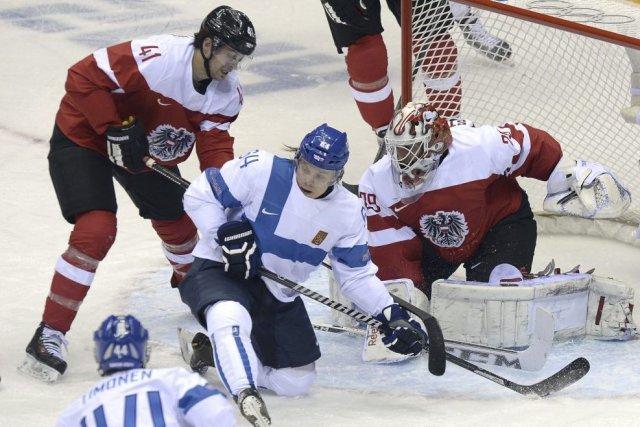 Mikael Granlund, au centre, a marqué deux buts,... (PHOTO ALEXANDER NEMENOV, AFP)
