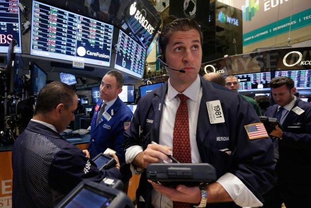 Wall Street a fini en baisse mercredi, inquiète après des commentaires du Fonds... (PHOTO ASSOCIATED PRESS)