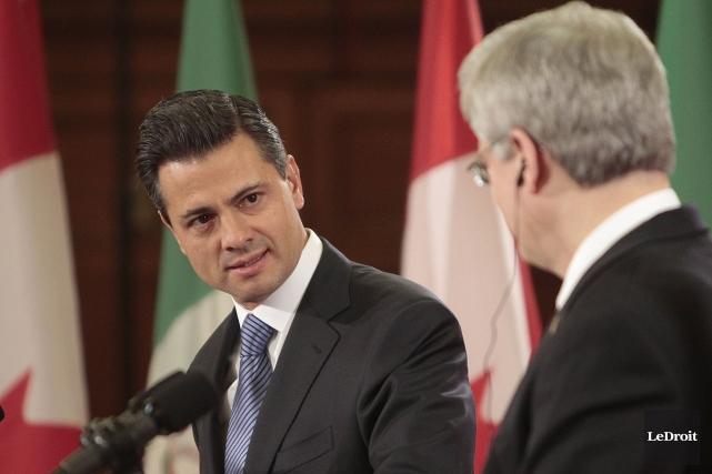 Le président mexicainEnrique Pena Nieto (à gauche) et... (Photo Étienne Ranger, Archives Le Droit)
