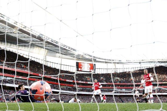 Le but du joueur de l'Arsenal, Alex Oxlade-Chamberl... (Photo DARREN STAPLES, Reuters)