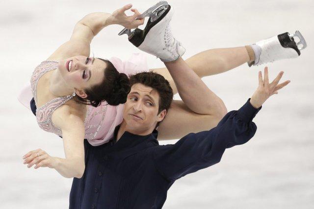 Les Canadiens Tessa Virtue et Scott Moir ont... (Photo Bernat Armangue, AP)