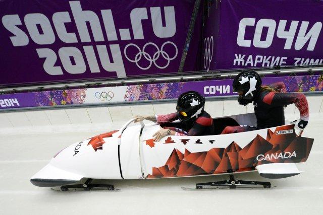 Les Canadiennes Kaillie Humphries et Heather Moyse au... (Photo Lionel Bonaventure, AFP)