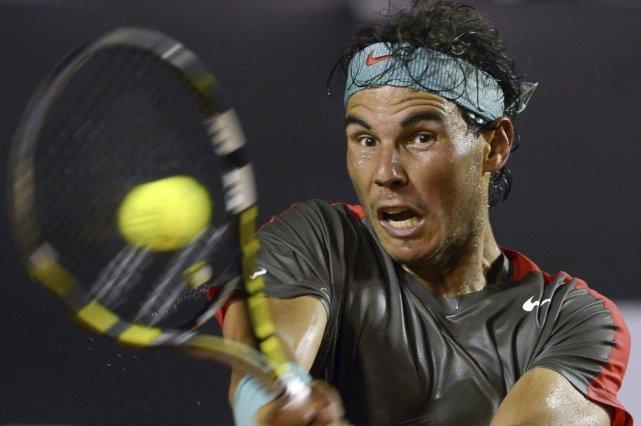 Nadal a converti six occasions de bris sur... (Photo AFP)