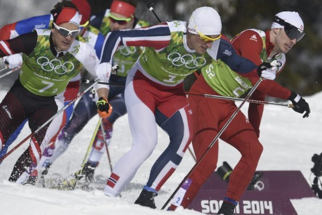 Petter Northug (1) et Gianluca Cologna (5) batailleront... (ODD ANDERSEN)
