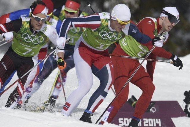 Petter Northug (1) et Gianluca Cologna (5) batailleront... (ODD ANDERSEN)