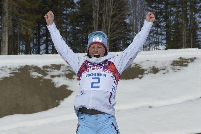 Marit Bjoergen a devancé deux compatriotes norvégiennes.... (Photo ALBERTO PIZZOLI, AFP)
