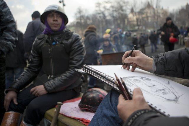 Un manifestant se faisait tirer le portrait hier... (Photo Darko Bandic, AP)