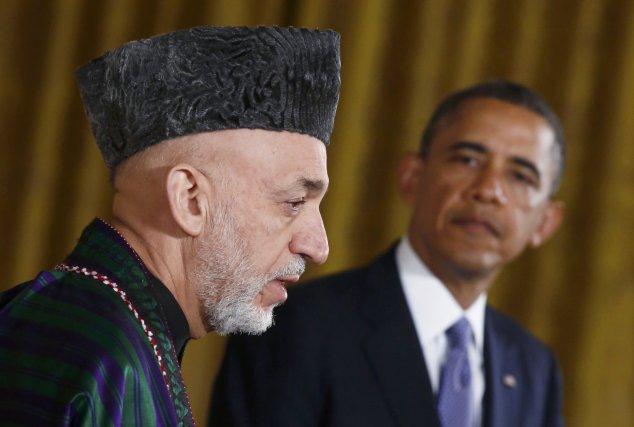Le président afghan Hamid Karzaï en compagnie de... (Photo archives Reuters)