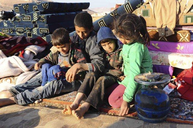Sur 200 000 enfants ayant fui la Syrie,... (Photo AFP)