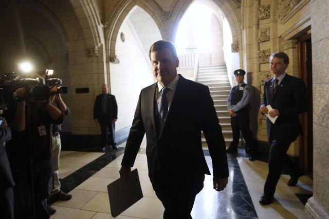 Le ministre des Affaires étrangères, John Baird... (Photo CHRIS WATTIE, Reuters)