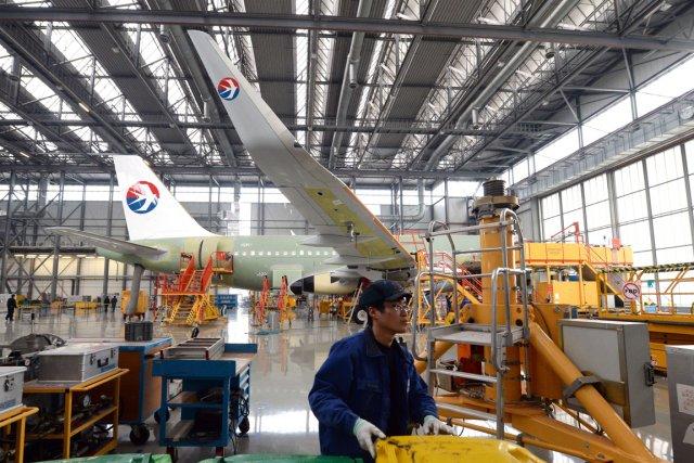 China Eastern, une des trois plus grosses compagnies... (PHOTO GOH CHAI HIN, AFP)