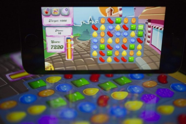 Des jeux comme Candy Crush Saga, Angry Birds ou encore Clash of... (Photo Andrew Harrer, Bloomberg)