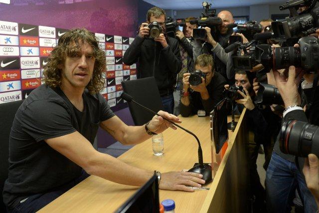 Le défenseur Carles Puyol est le capitaine du... (Photo Lluis Gene, AFP)
