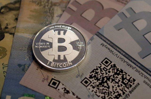 L'identité du créateur du bitcoin fait, depuis plusieurs... (PHOTO JIM URQUHART, REUTERS)