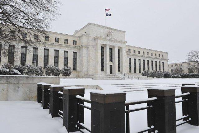 La Réserve fédérale, qui a réduit ses injections... (PHOTO KAREN BLEIER, AFP)
