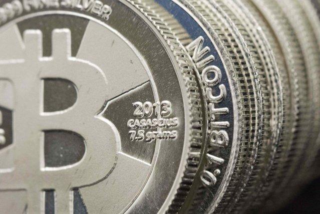 Le bitcoin très controversé, qui traverse une grave crise de confiance avec les... (Photo Jim Urquhart, Reuters)