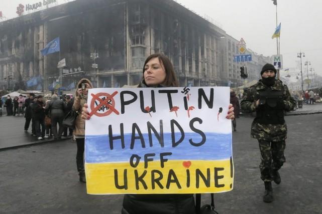 Stephen Harper a affirmé que l'invasion russe en... (Photo Efrem Lukatsky, AP)