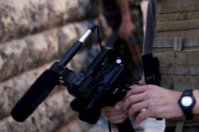 La soeur d'un photoreporter pigiste canadien affirme que son frère a été tué à... (Photo Manu Brabo, AP)