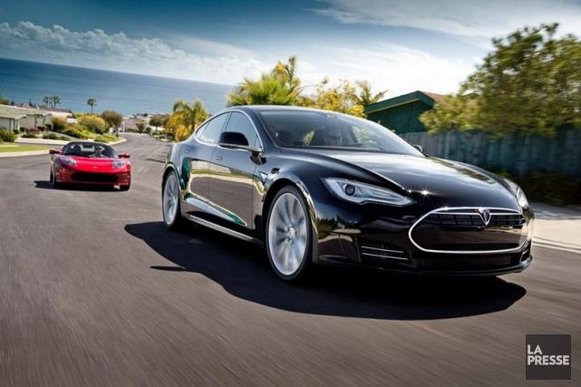 Tesla, qui a touché un sommet de 265...