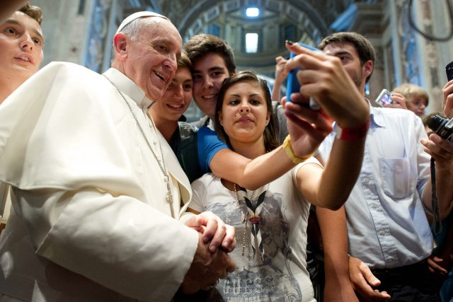 Le pape François a adopté un style chaleureux,... (Photo Associated Press)