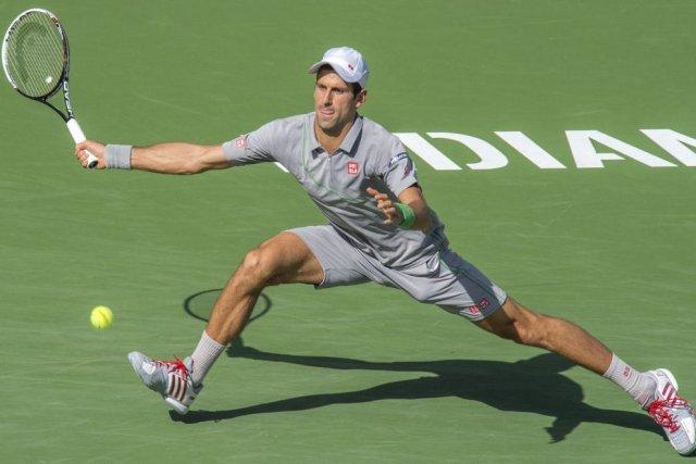 Novak Djokovic affrontera RogerFedererpour la33e fois.... (PHOTO JOE KLAMAR, AFP)