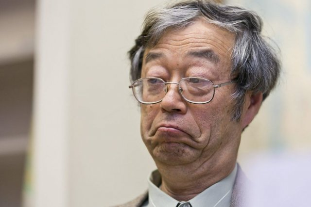 Dorian S. Nakamoto listens during an interview with... (Photo Damian Dovarganes, AP)