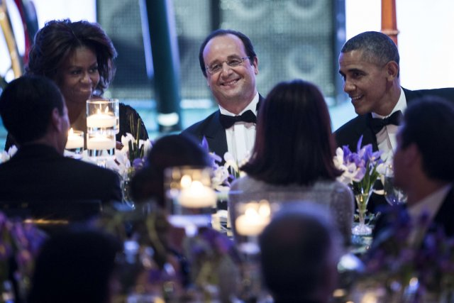 Michelle Obama, le président français François Hollande et... (Photo archives AFP)