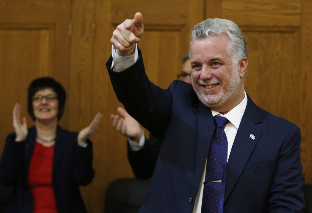 Le chef du PLQ, Philippe Couillard, cultive l'art... (Photo Mathieu Bélanger, Reuters)