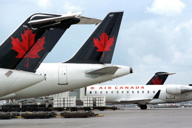 Un avion d'Air Canada a redécollé jeudi matin de l'aéroport international... (Archives AFP)