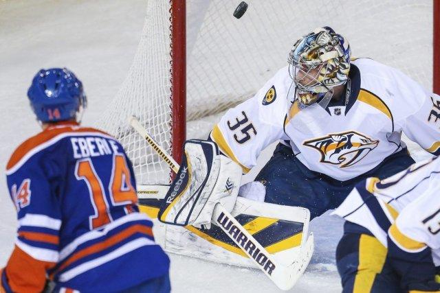 Jordan Eberle bat Pekka Rinne.... (Photo Sergei Belski, USA Today)