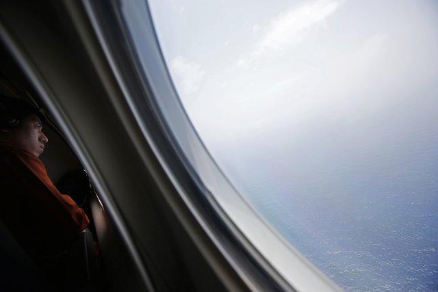 Trois semaines après la mystérieuse disparition du Boeing de Malaysia Airlines,... (Photo EDGAR SU, Reuters)