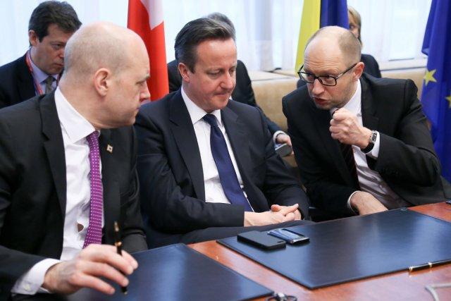 Les premiers ministres suédois,Fredrik Reinfeldt, britannique, David Cameron,... (Photo Associated Press)