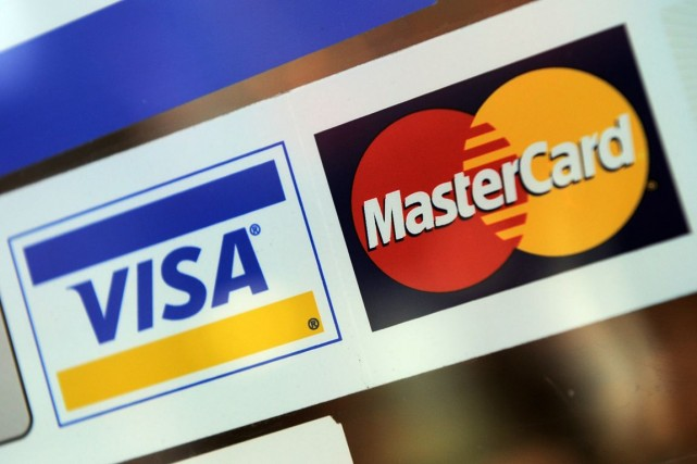 Les systèmes de paiement américains Visa et MasterCard vont poursuivre leurs... (Photo Sean Kilpatrick, archives La Presse Canadienne)