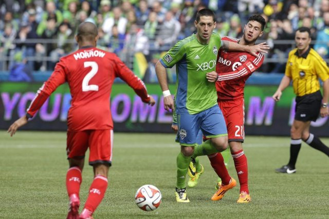 Clint Dempsey (au centre).... (PHOTO TED S. WARREN, AP)
