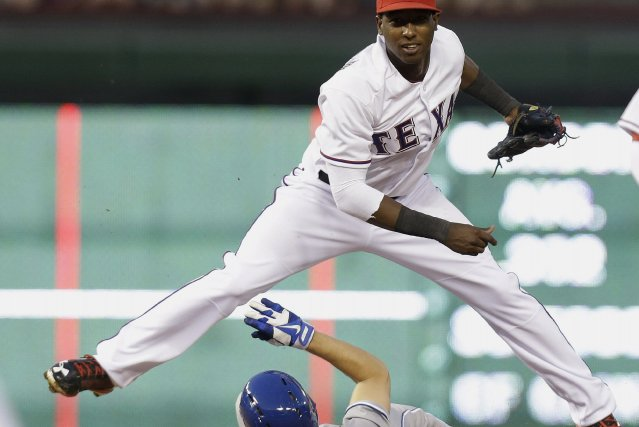 Le deuxième-but des Rangers du Texas Jurickson Profar... (Photo LM Otero, AP)