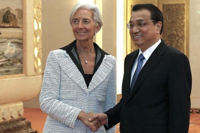 La directrice générale du FMI Christine Lagarde et... (PHOTO LINTAO ZHANG, AFP)