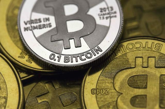 Le bitcoin,a plus importante des cryptomonnaies, créée en... (PHOTO JIM URQUHART, ARCHIVES REUTERS)