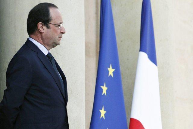 Le président François Hollande s'est engagé mardi à... (PHOTO THIBAULT CAMUS, AP)