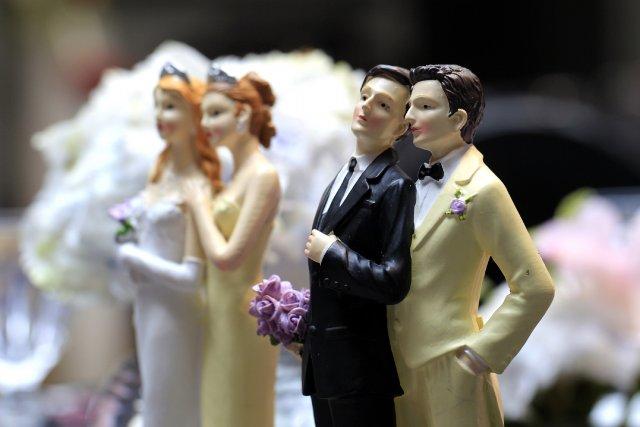 Les couples homosexuels bénéficient en effet déjà des... (Photo GONZALO FUENTES, Reuters)